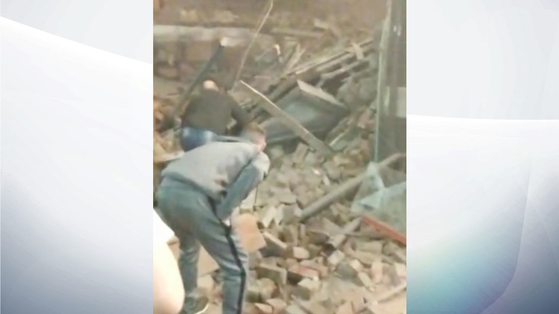 Local residents tried to search through the rubble