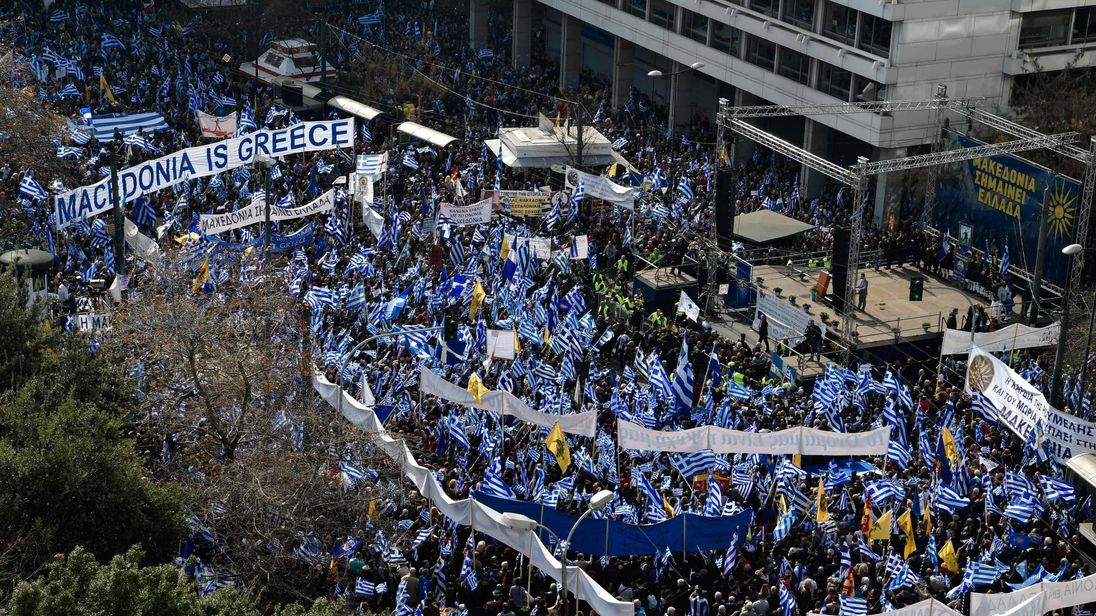 Demonstrators wave Greek national flags during a demonstration in Athens on February 4, 2018. Hundreds of thousands of Greeks are expected to join an Athens rally to urge the government not to compromise in the festering name row with neighbouring Macedonia, organisers said