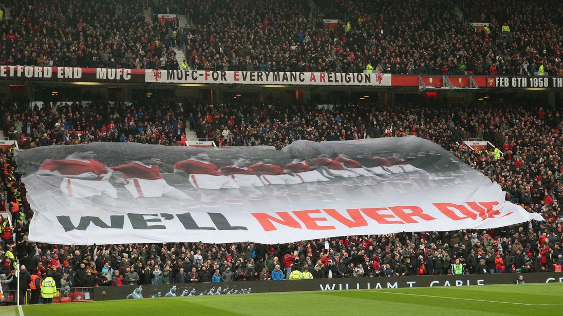 Manchester United fans display a banner commemorating the 60th Anniversary of the Munich Air Disaster ahead of the Premier League match between Manchester United and Huddersfield Town at Old Trafford on February 3