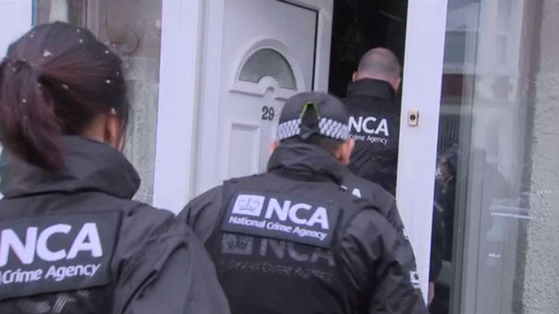21 arrested after raids target migrant smuggling gang