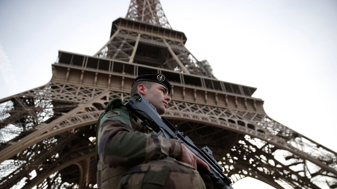 A French soldier, part of the 'Operation Sentinelle', patrols in front of the Eiffel Tower on November 1, 2017 in Paris, as France officially ends the state of emergency