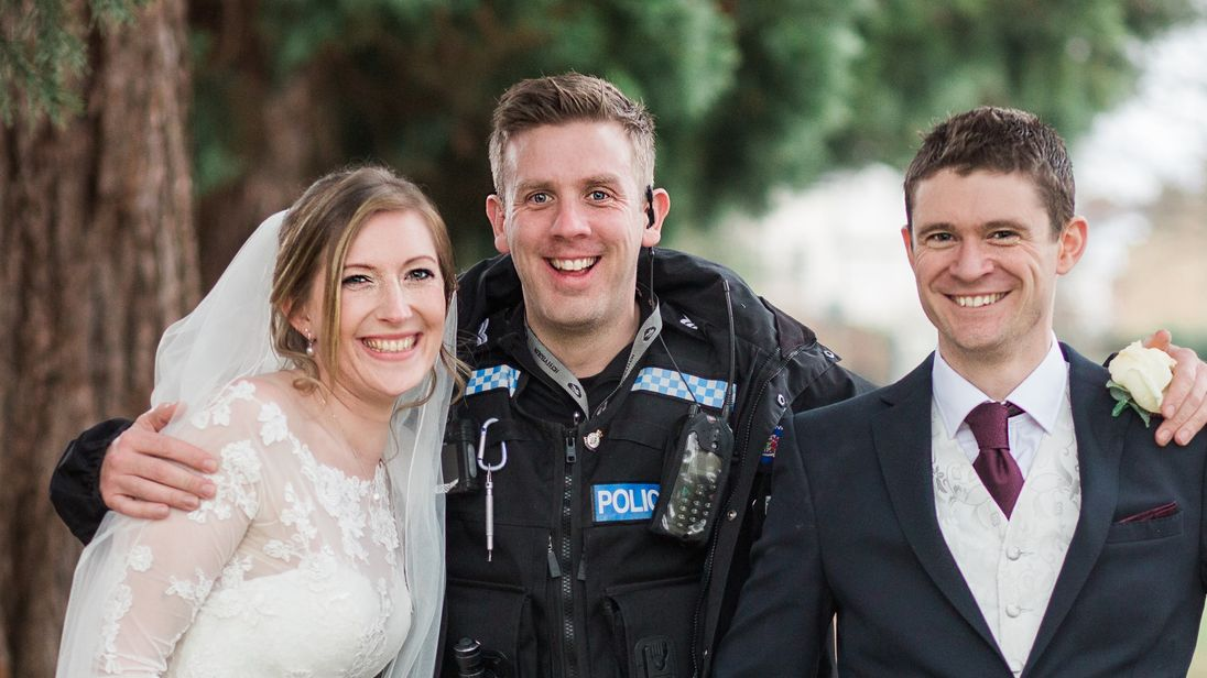Police made time for photos with the married couple after making the arrests. Pic: Annie Crossman Photography