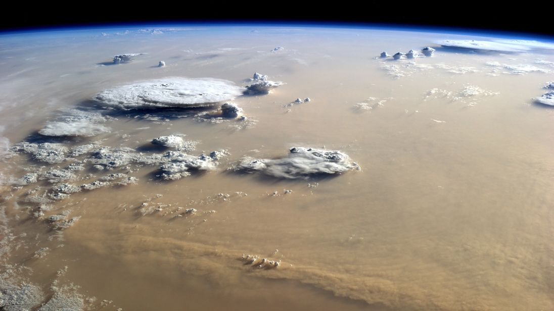 Title Sandstorm over the Sahara..Released 18/09/2014 2:42 pm..Copyright ESA/NASA..Description..A sandstorm over the Sahara desert in Africa seen by ESA astronaut Alexander Gerst from the International Space Station.....Working 400 km above our planet, Alexander is taking beautiful pictures in his spare time. Follow his Blue Dot mission via http://alexandergerst.esa.int