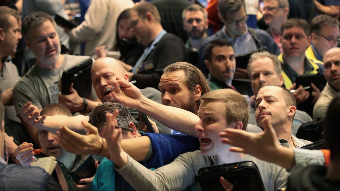 Traders signal offers in the S&P options pit at the Cboe Global Markets on 6 February