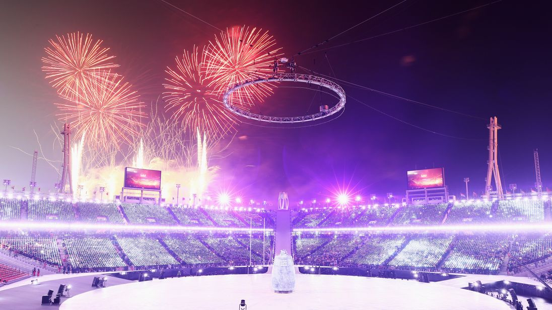 Fireworks light up the sky as the Winter Olympics opening ceremony begins