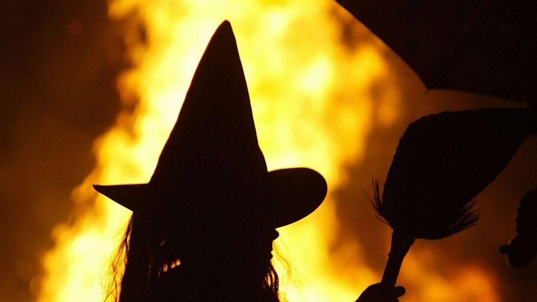 HUNTINGTOWN, MD - OCTOBER 25: Dressed as a witch, Leigh Kosega stands near a bonfire October 25, 2003 in Huntingtown, Maryland. With the sniper suspect arrested, parents in the Washington, DC-area feel a little safer about having their children go 'trick or treating' on Halloween night this year. (Photo by Mark Wilson/Getty Images)