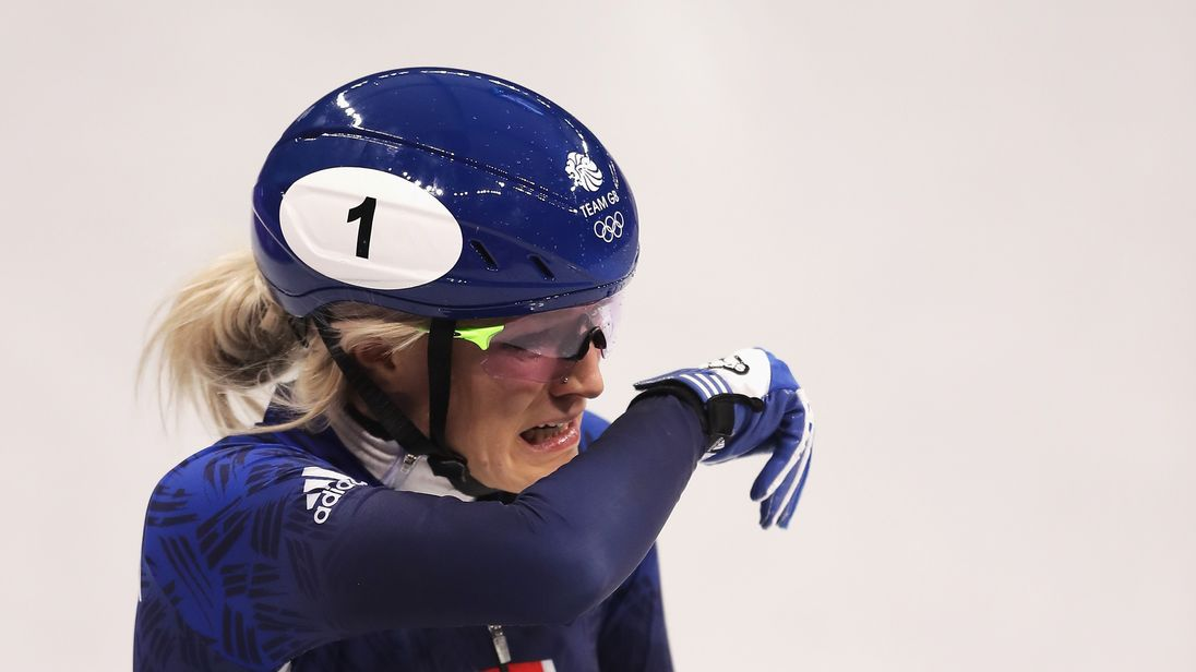 Elise Christie appears visibly upset after crashing during the Women's 500m Short Track Speed Skating final