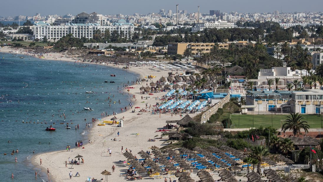 Tourists enjoy the beach on June 25, 2016 in Sousse, Tunisia.