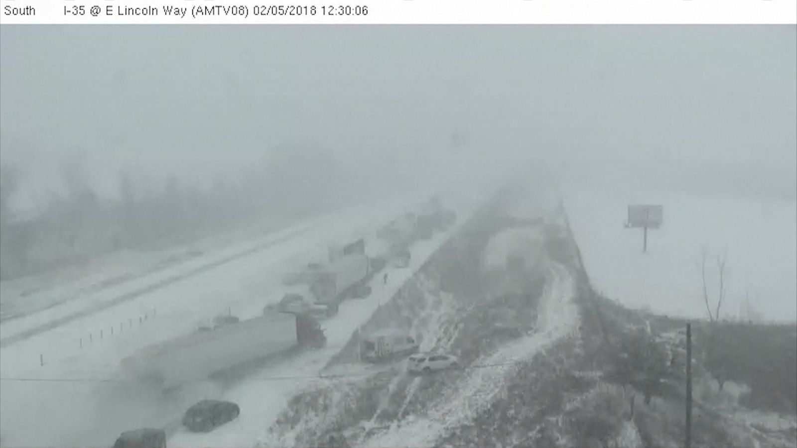 One person dies and up to 70 vehicles are involved in the accident on the  snow-covered interstate