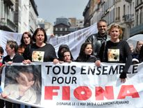 "People take part in a ""white march for Fiona"" on May 11, 2014 in Clermond Ferrand, southern France"