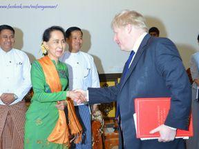 Boris Johnson shakes hands with Aung San Suu Kyi