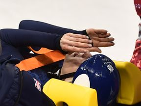 Elise Christie is moved on a stretcher after crashing in the women's 1,500m short track speed skating semi-final event