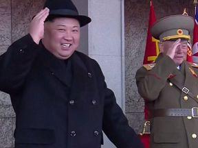 Kim Jong Un watches a military parade in Pyongyang