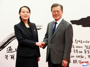 South Korean President Moon Jae-in shakes hands with Kim Yo Jong, the sister of North Korea's leader Kim Jong Un