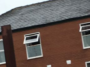 Blood can be seen on the second-floor window of a flat in Swan Street. Pic: Jonathan Ward