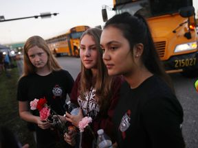 Students carried roses on their return to school