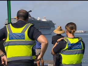 The Carnival Legend arrives into Melbourne as police watch on. Pic: Channel 7