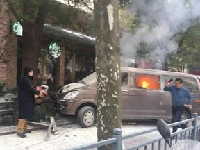The minivan mounted the pavement and burst into flames Pic: People's daily, China