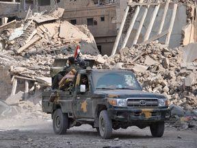 Pro-regime forces patrol in Deir al-Zor city. File pic