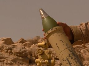 A government soldier prepares to launch a mortar in Yemen