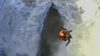 Dramatic footage has just been released showing the incredible moment a Coastguard winchman was battered by 6ft waves as he rescued two young men off Hartland Point, North West Devon