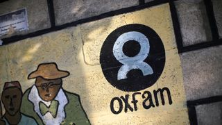 An Oxfam sign on a wall in Corail, a camp for displaced people of the earthquake of 2010, on the outskirts of Port-au-Prince, Haiti