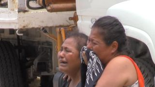 Local women mourn at a crime scene