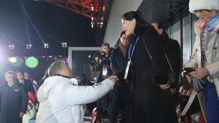 South Korean President Moon Jae-in shakes hands with Kim Jong Un's younger sister Kim Yo Jong