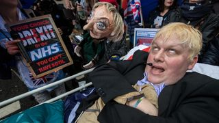 A Boris Johnson lookalike was wheeled through the streets