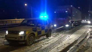 Police in Kent tow a broken down lorry
