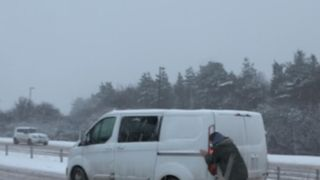 Heavy snow around the UK and Ireland is making driving conditions very difficult on the roads