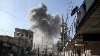 A smoke plume rises following an airstrike in Ghouta