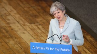Theresa May delivers a speech to students and staff during her visit to Derby College