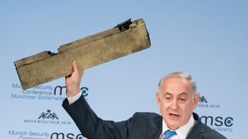 Israeli Prime Minister Benjamin Netanyahu holds up a remnant of what he said was a piece of Iranian drone which was shot down in Israeli airspace. Lennart Preiss/MSC Munich Security Conference/Handout via REUTERS -