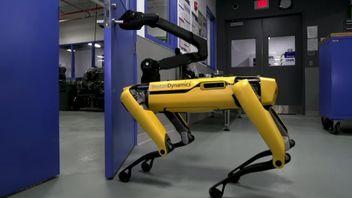 Robot dog opening door in labratory.