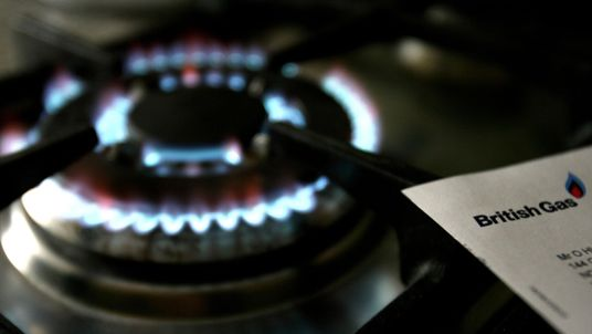 "File photo dated 08/02/07 of a gas hob with a bill from British Gas, whose owner Centrica has blamed ""significantly reduced profit"" in its UK business for pushing group operating profits down 17\% to £1.25 billion."