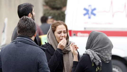 Relatives of Iranian passengers, onboard the Aseman Airlines flight EP3704, react as they gather in front of a mosque near Tehran's Mehrabad airport on February 18, 2018