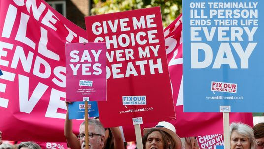 Pro assisted dying campaigners protest outside the Houses of Parliament