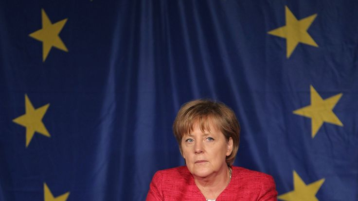 Angela Merkel in front of a European flag