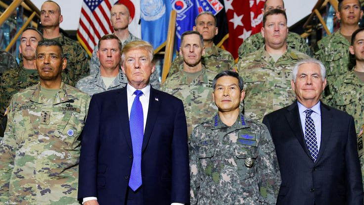 U.S. President Donald Trump poses for a photo with military commanders at the U.S. Eighth Army Operation Command Center at U.S. military installation Camp Humphreys in Pyeongtaek, South Korea