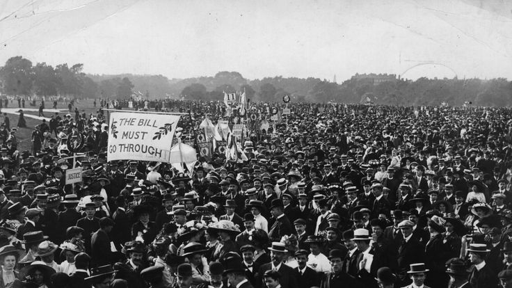 Men and women campaigning at a suffragette meeting in London's Hyde Park