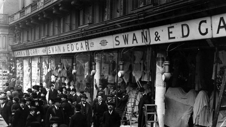 The aftermath of a suffragette window-smashing spree on a department store in London