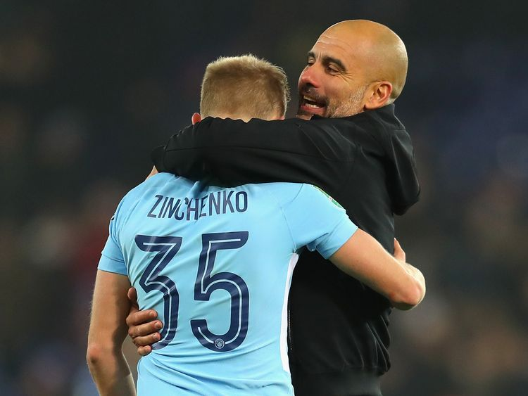 Oleksandr Zinchenko and Pep Guardiola of Manchester City celebrate penalty shootout victory over Leicester in the Carabao Cup