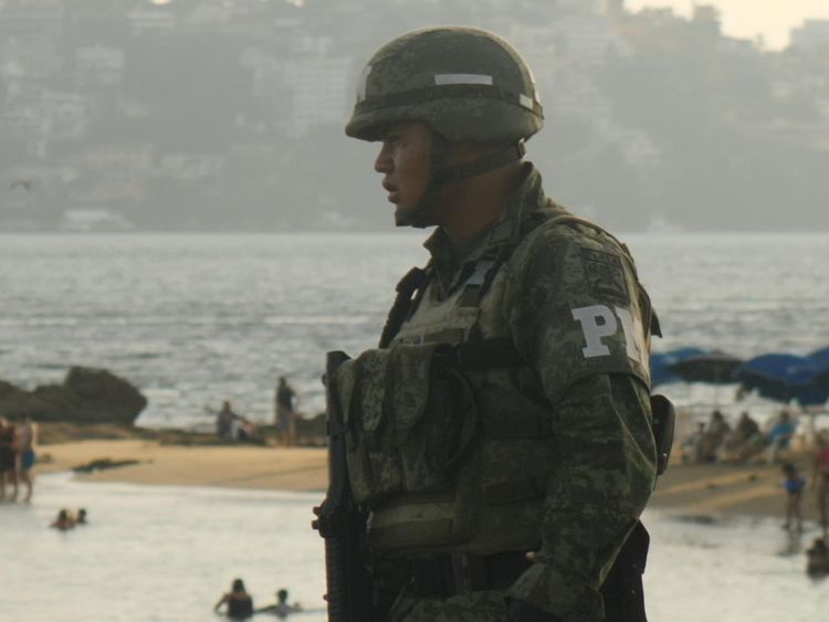 A police office guards the beach in Acapulco
