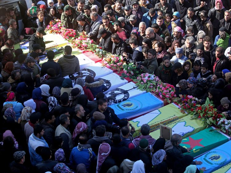Syrian Kurds mourn during a funeral in the town of Afrin on January 29, 2018, of civilians and fighters from the Syrian Kurdish People's Protection Units (YPG) who were killed in battles in Syria's border region of Afrin as the Turkish army press an offensive against Kurdish militia in the area. Turkey launched operation 'Olive Branch' on January 20 against the YPG militia in Afrin, supporting Syrian opposition fighters with ground troops and air strikes