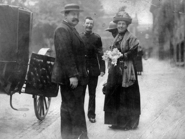 Alice being escorted from the court to prison in 1913 for the crime of digging the words 'votes for women' out of the putting green of a local golf course.  Pic: Peter Barratt