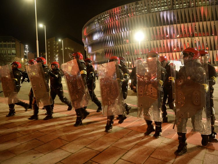 Riot police outside the stadium before the match