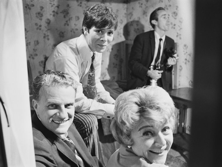 Dora Bryan (1923 - 2014), Billy Graham, and Cliff Richard, on the set of 'Two a Penny', 1967