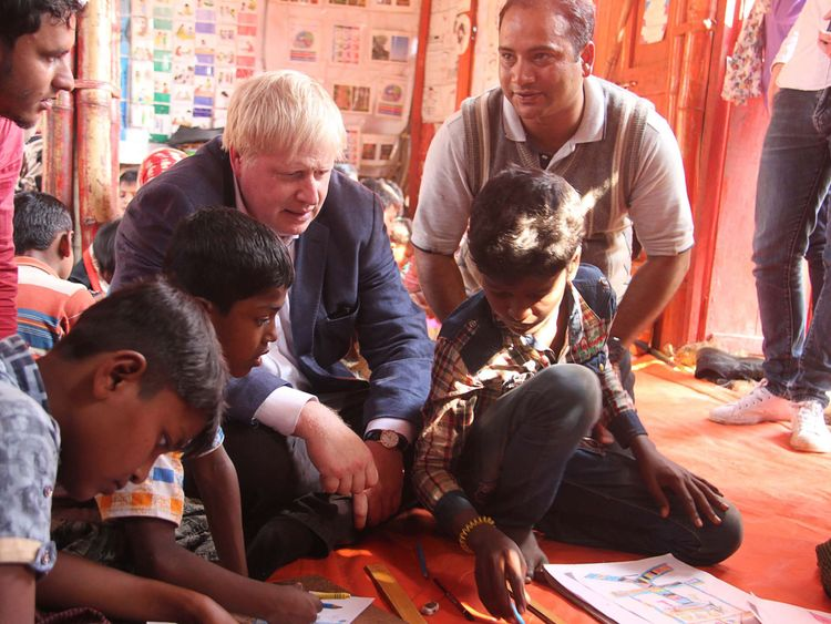 British Foreign Secretary Boris Johnson (C) meets with Rohingya refugees at a camp in Bangladesh's Cox's Bazar district on February 10, 2018. Johnson visited camps for Rohingya refugees who have fled from Myanmar, on his second day of a two-day visit to Bangladesh. / AFP PHOTO / - (Photo credit should read -/AFP/Getty Images)