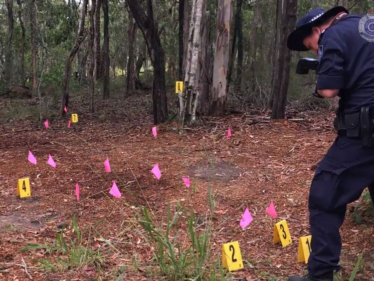 Officers examine the site of the incident. Pic: Australian Police Service